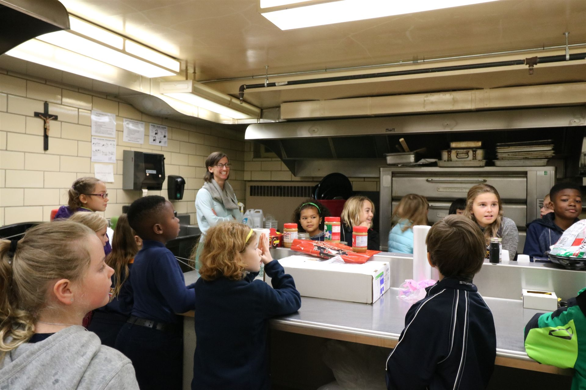 Students listen to instruction on how to fill boxes at the Riverwest Food Pantry.