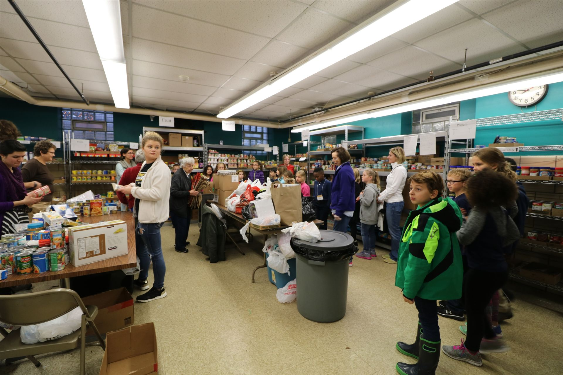 Students learn about the operation of the Riverwest Food Pantry.