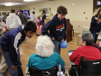 Playing games during a visit to the assisted living facility