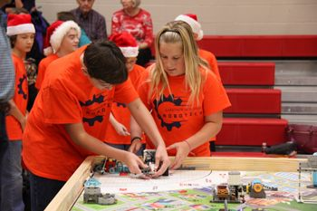 The Middle School Orange team competing at a FLL qualifier. They would go on to win Best Robot Design Award.