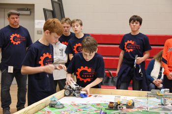 The Middle School Blue team competing at a FLL qualifier. They would go on to win Best Project Award.