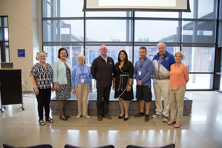 Trinity School of Midland alumni and faculty in the Commons.