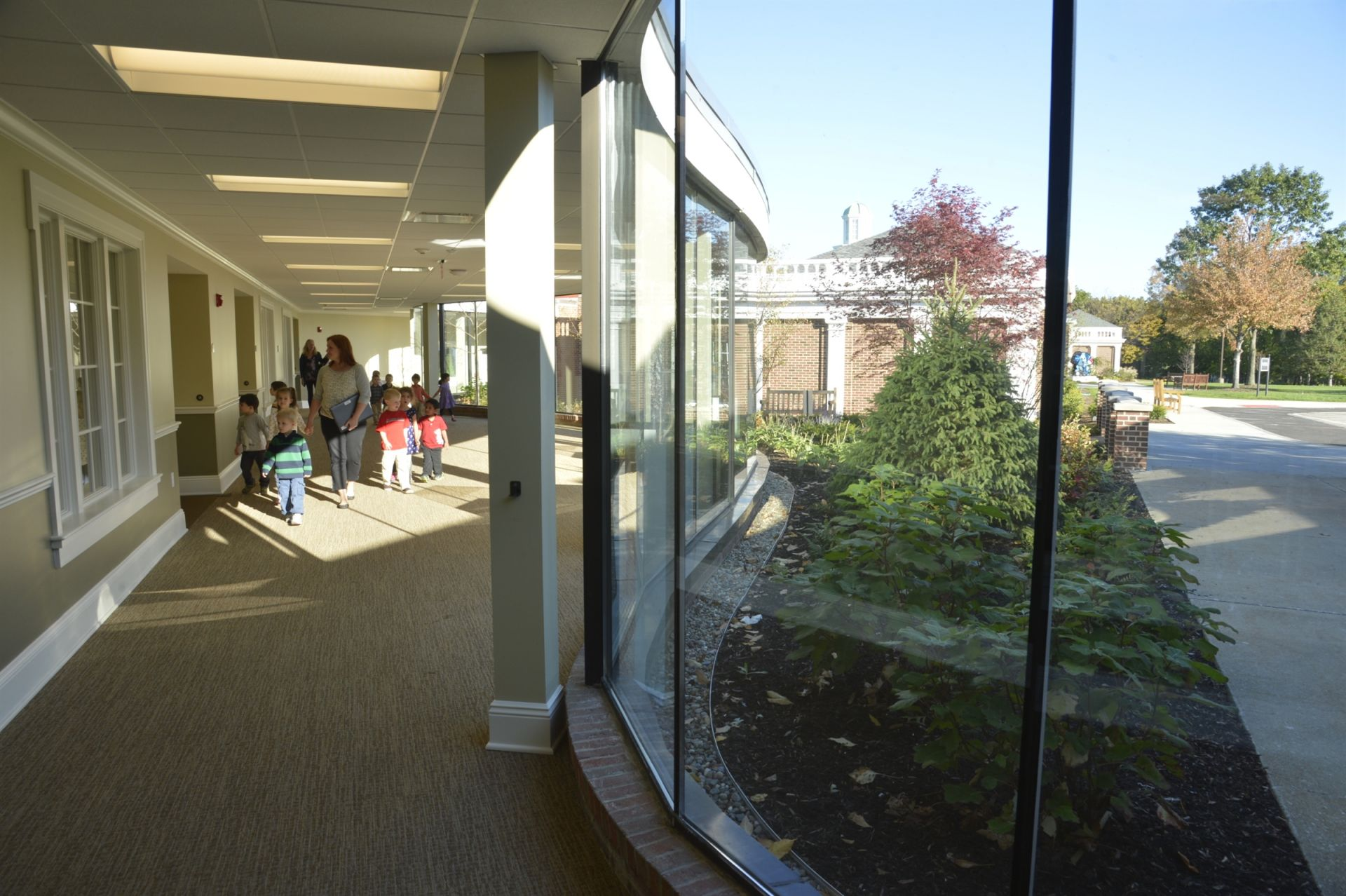 The Musical Arts Center hallway looks out onto the White Family Memorial Garden.