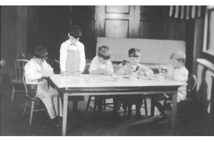 Either 1572 or 1588 Ansel Road. Five small boys at a low table.