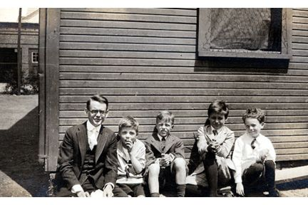 1588 Ansel Road., c. 1918. Third Grade. L-R: Mr. Kingdon, David Weir, John Lincoln, Stevenson Burke, Dwight Smith.