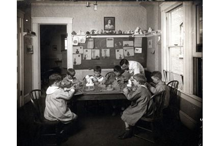 Ansel Road. Joseph Motto (1915-1928) and students in studio.