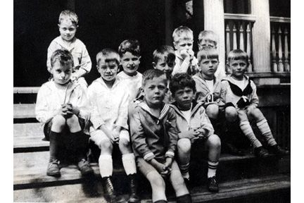 1588 Ansel Road,  First Grade, June, 1921. Back row L-R: Jimmy Ireland, Bill Osborne, Stephen Blossom. Middle row L-R: Lewis Baldwin, Henry Harvey, Everett Sholes, Timmy Perkins, Willard Brown, Bee [Herman] Peck. Front row L-R: Winthrop Barnes, John Harshaw.