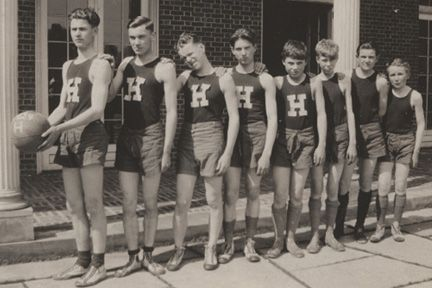 1924 Basketball team, Bolton Hall Patio, printed in The Red and Gray Book, 1924, p. 52. People: Unnamed. On the team were Bauman, D. Weir, Urban, Taylor, J. Weir, Maeder, and subs. Collens, W. Weir, , D. Baker, R. Baker.