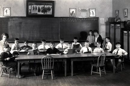 Bolton Hall classroom, Lyndhurst, 1928. Back row L-R: Mary T. Adams, Scott Inkley, Dwight Morse, Henry Wischmeyer, Frederick Hills, John Sawyer, Arthur Bazely, Fannie Luehrs, Jeffrey Cuddy. Front row L-R: Dean Morse, Theodore Peck, Elton Hoyt, Robert White, Melville Ireland, Frank House, Marshall Dyers.