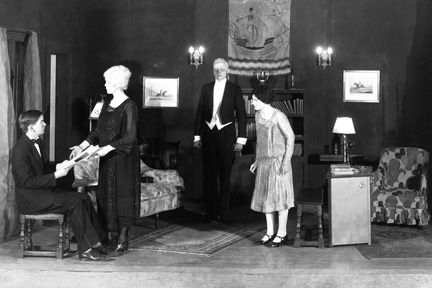1928-1929. Lyndhurst chapel: 'Captain Applejack' by Walter Hackett. Directors: teacher Robert S. Adams (1925-1934), teacher Seward Covert (1927-1929). Stage manager: Richard Inglis '29. First evening performance in Hawken history. L-R: John Calfee '31 [Ambrose Applejohn], At a guess (because heroines are usually blonde) Adrian Foose '31,[Poppy Faire, Jack's niece], Courtney Burton '30 [Lush, the Butler], and at a guess (because aunts swoon) Guthrie Bicknell '30 [Jack's Aunt Agatha].