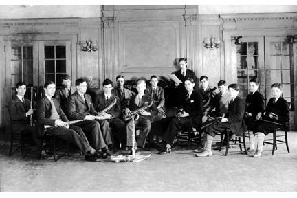 Bolton Hall Common Room, Lyndhurst, 1929. Members of orchestra. L-R: Frederick White [flute], John Harshaw [clarinet], Jonathan Collens, William Nash [saxophone], Richard Inglis [saxophone], ?, Ben Taplin [saxophone], ? [percussion], Albert Conkey (rear standing) [piano], John Calfee [first violin], George Armour Craig or Harry Royal [rear], ? Frank Taplin.