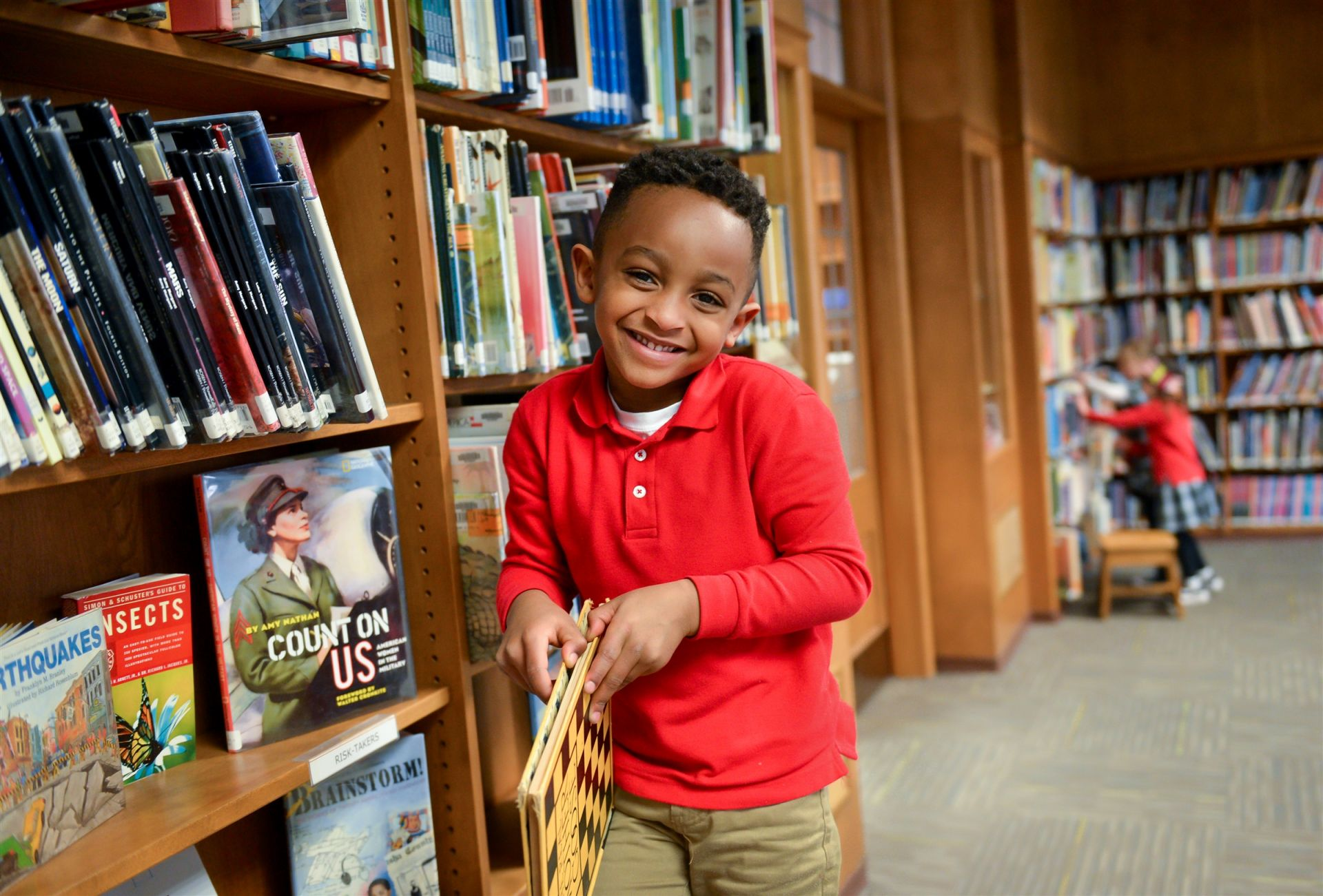 Elementary Student in School Library