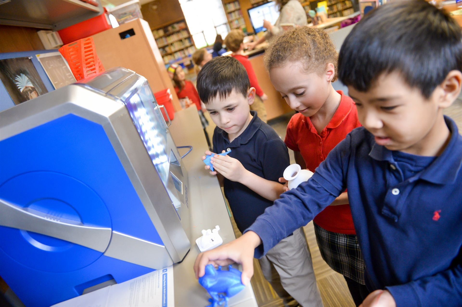 Private Elementary School Boys using a 3-D printer