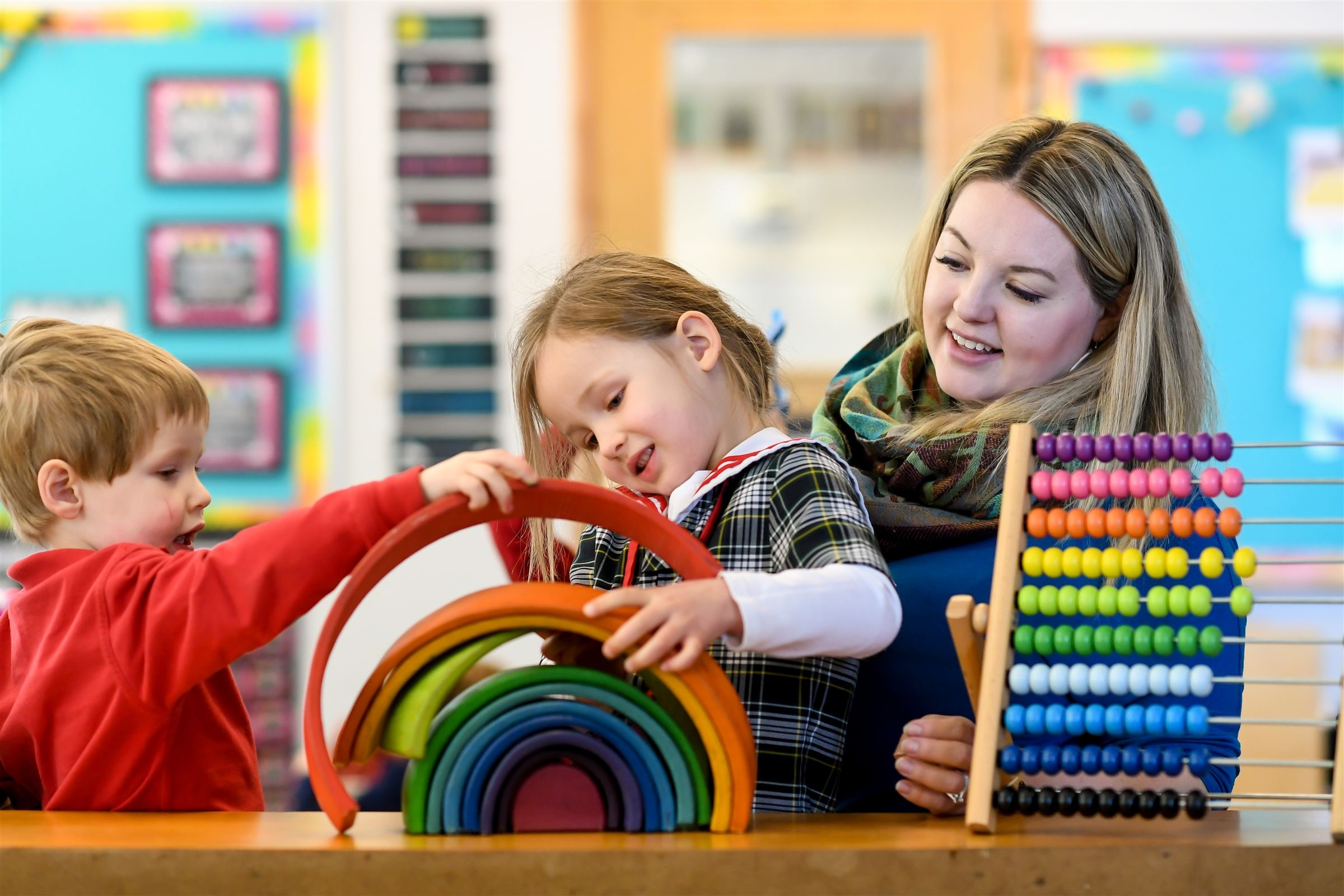 Large classrooms with cozy spaces and beautiful learning toys are a hallmark of our Preschool.