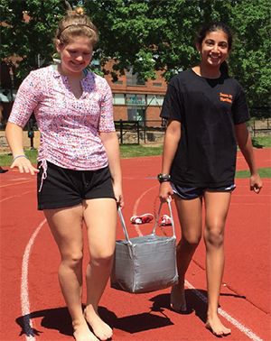 Students design and build a watertight container using duct tape, cardboard, and a meter of rope to transport ten liters of water for one mile.