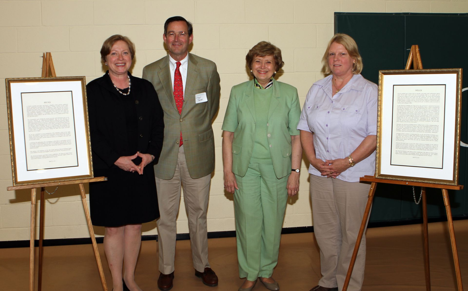 2011: Becky Gilmore (left) and Nelly Sheehan (right) pose with Board of Trustees President Stuartt Thayer and Head of School Mary Louise Leipheimer.