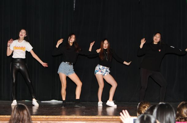 Sophomore Wendy X. and juniors Izzie C., Yiming Z., and Sumi L. were in step during their choreographed K-Pop (Korean pop music) dance!