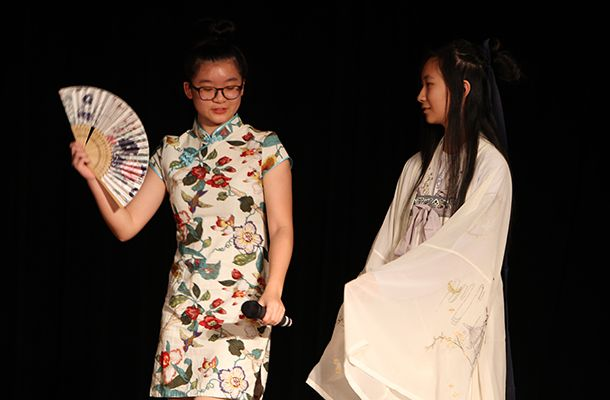 Freshmen Joy W. and Leslie W. donned traditional Chinese attire while singing a song about a beautiful ancient place.