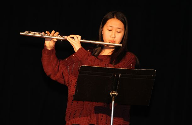Emily Z. '20 played the flute and  Maya Y. '20 played the piano during another musical offering from China.