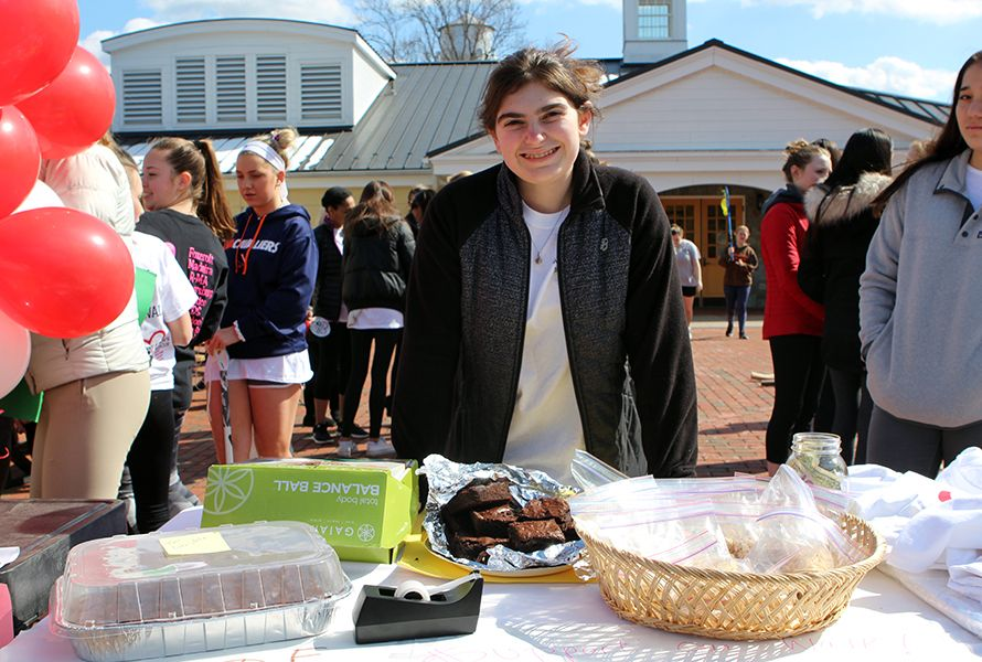 Bella B. '19 manned the sales table, where participants could purchase delicious baked goods. . .