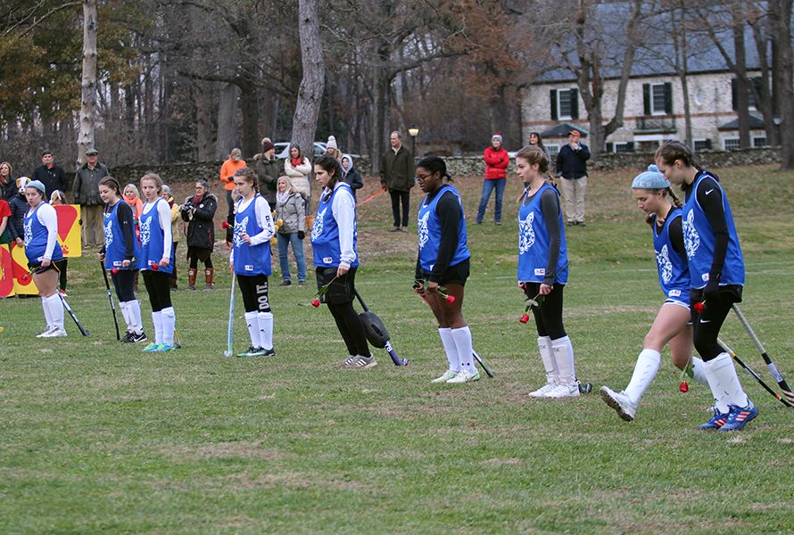 Both teams began to make their way across the field in a measured and traditional march. . .