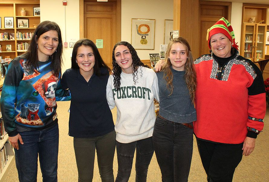 Before diving into their festive projects, students and faculty were treated to stories of giving shared by English students — Elisabeth W. '23, Angelina L. '23, and Holland B. '23, here with English Department faculty Lindsay O'Connor and Anne Burridge.