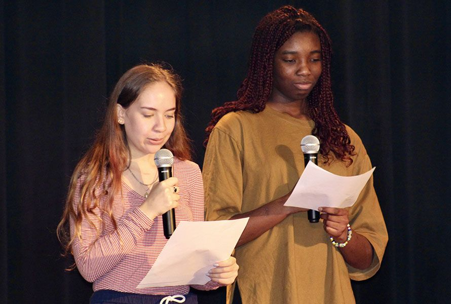 Liliana G. '21 read a poem in Spanish and Chelsie read the English translation.