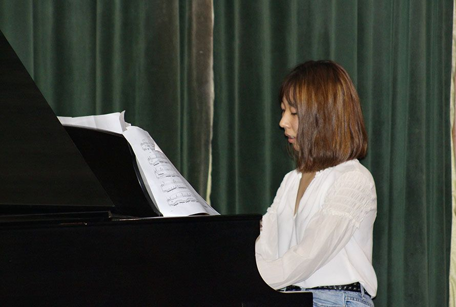 Maya Y. '20 performed a traditional Chinese song on piano.