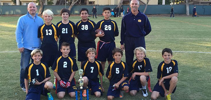 6th Grade Boys' Flag Football, led by Coach Peters and Coach (Mr.) Coleman