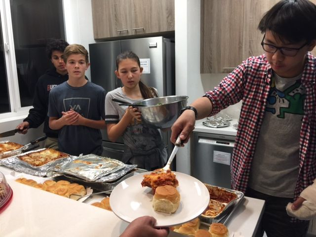 Students serve food to the hungry at Friendship Shelter.