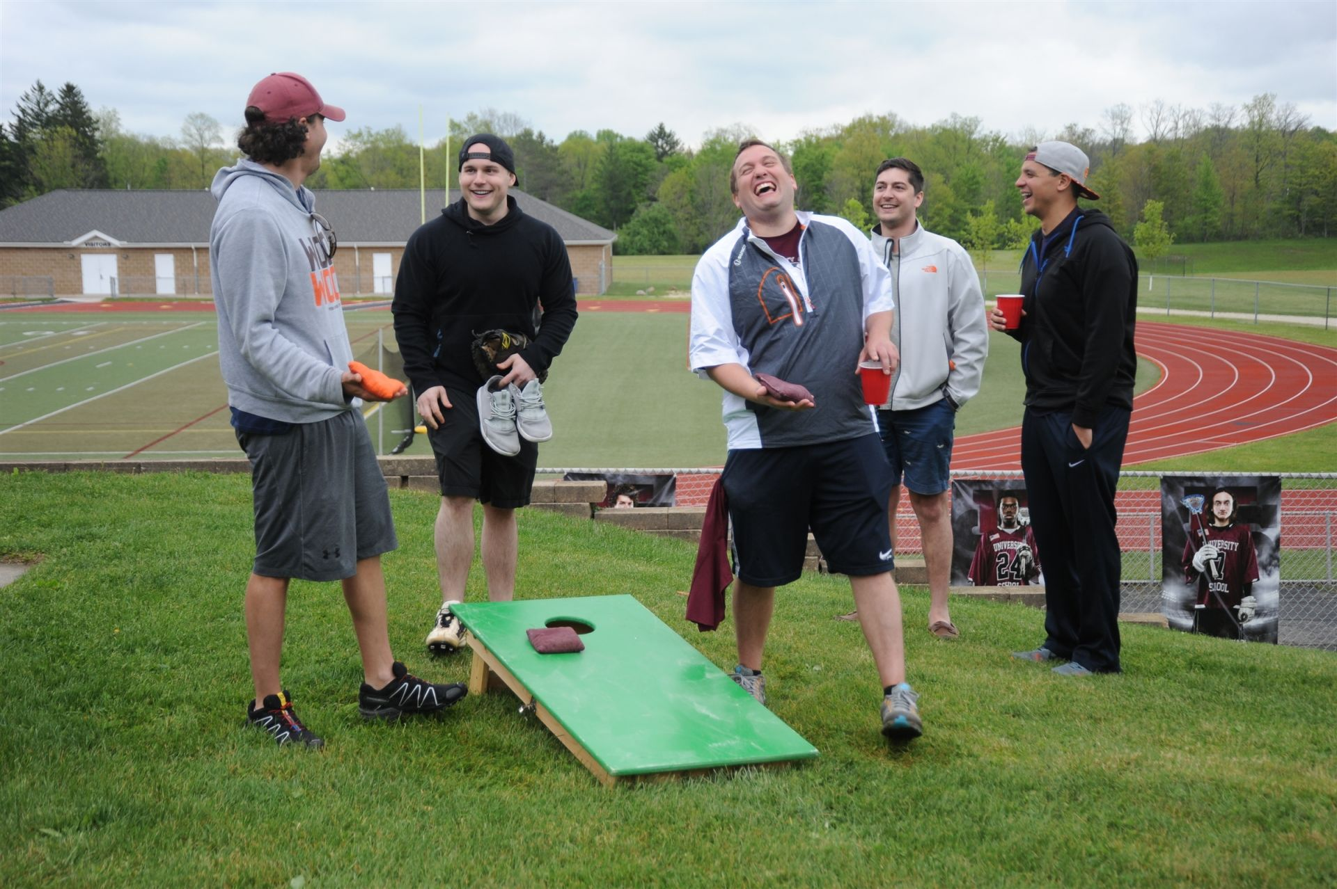 Members of the Class of 2006 play corn hole