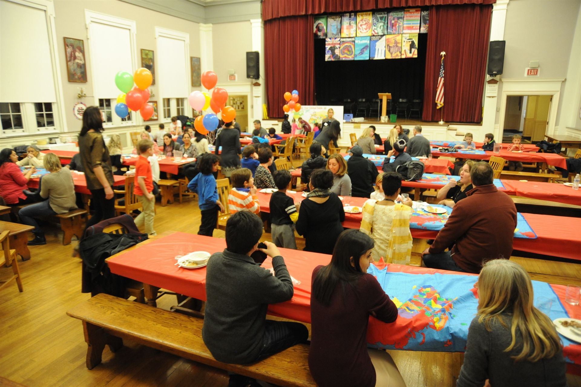 Students and parents enjoy cuisine from around the world at the Multicultural Potluck