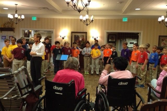 Lower School students sing to residents of an Alzheimer's Center