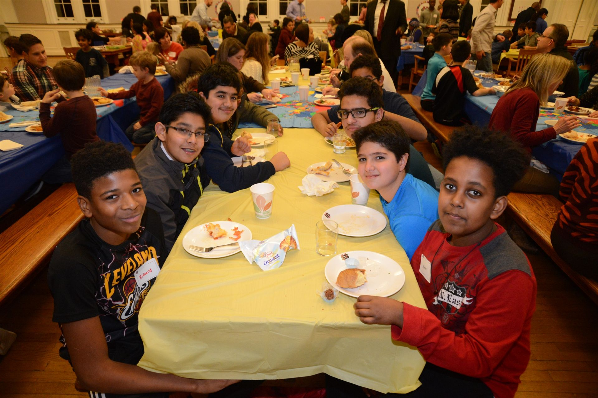 Students and their family's enjoy food from around the world at our Global Table potluck