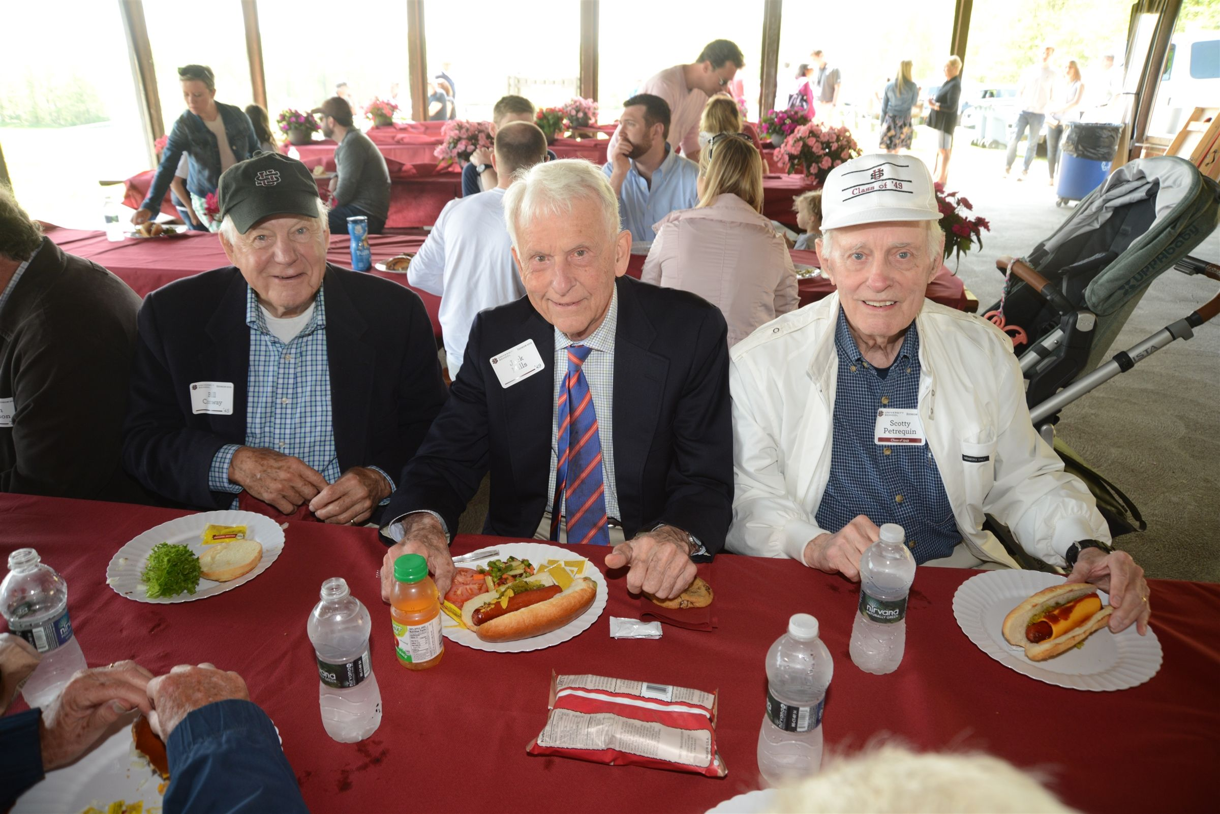 Bill Conway '45, Jack Mills '49, and Scott Petrequin '49 enjoy some picnic fare!