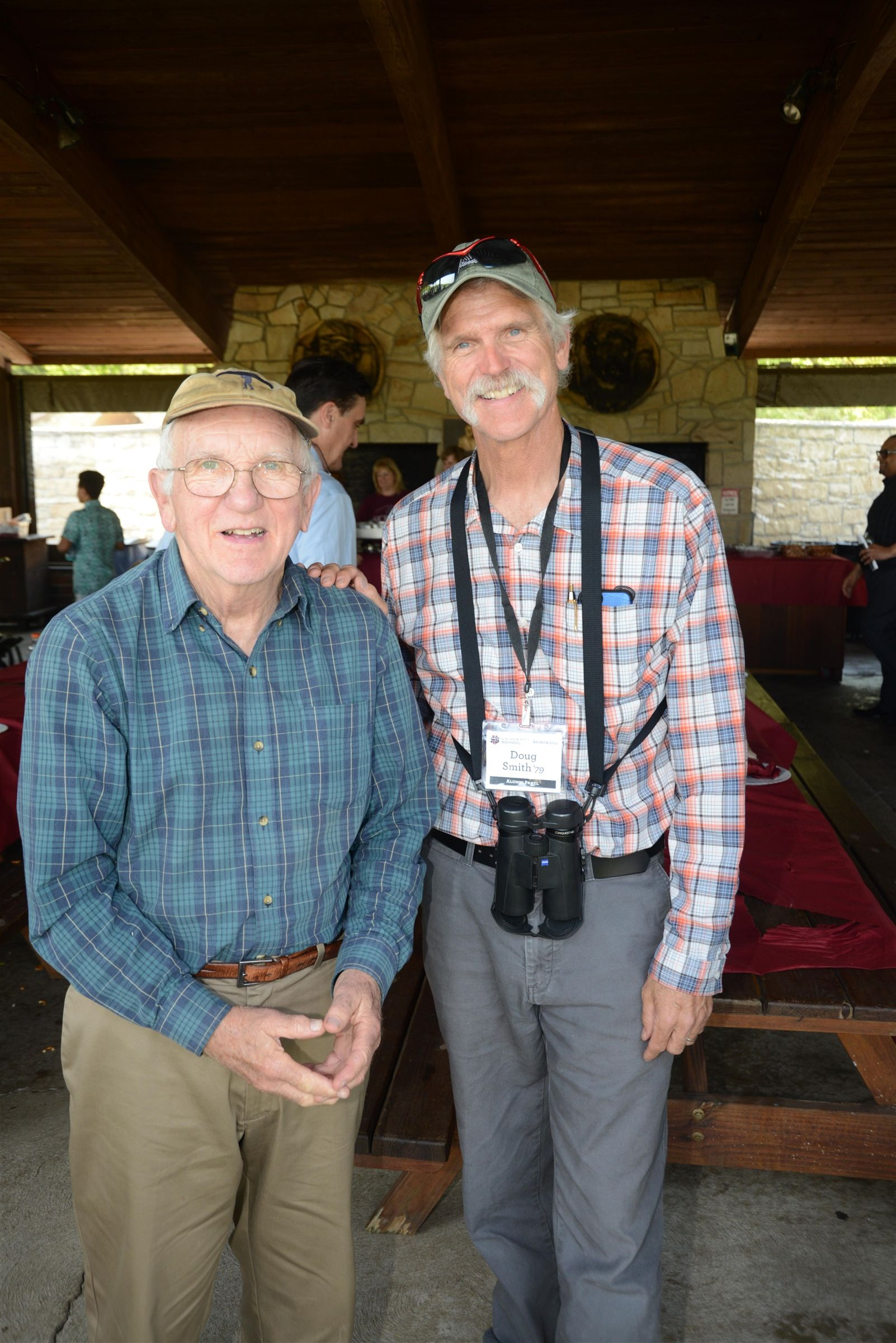 US faculty legend Terry Harmon and Doug Smith '79 led an outdoor campus tour after the Alumni Picnic.