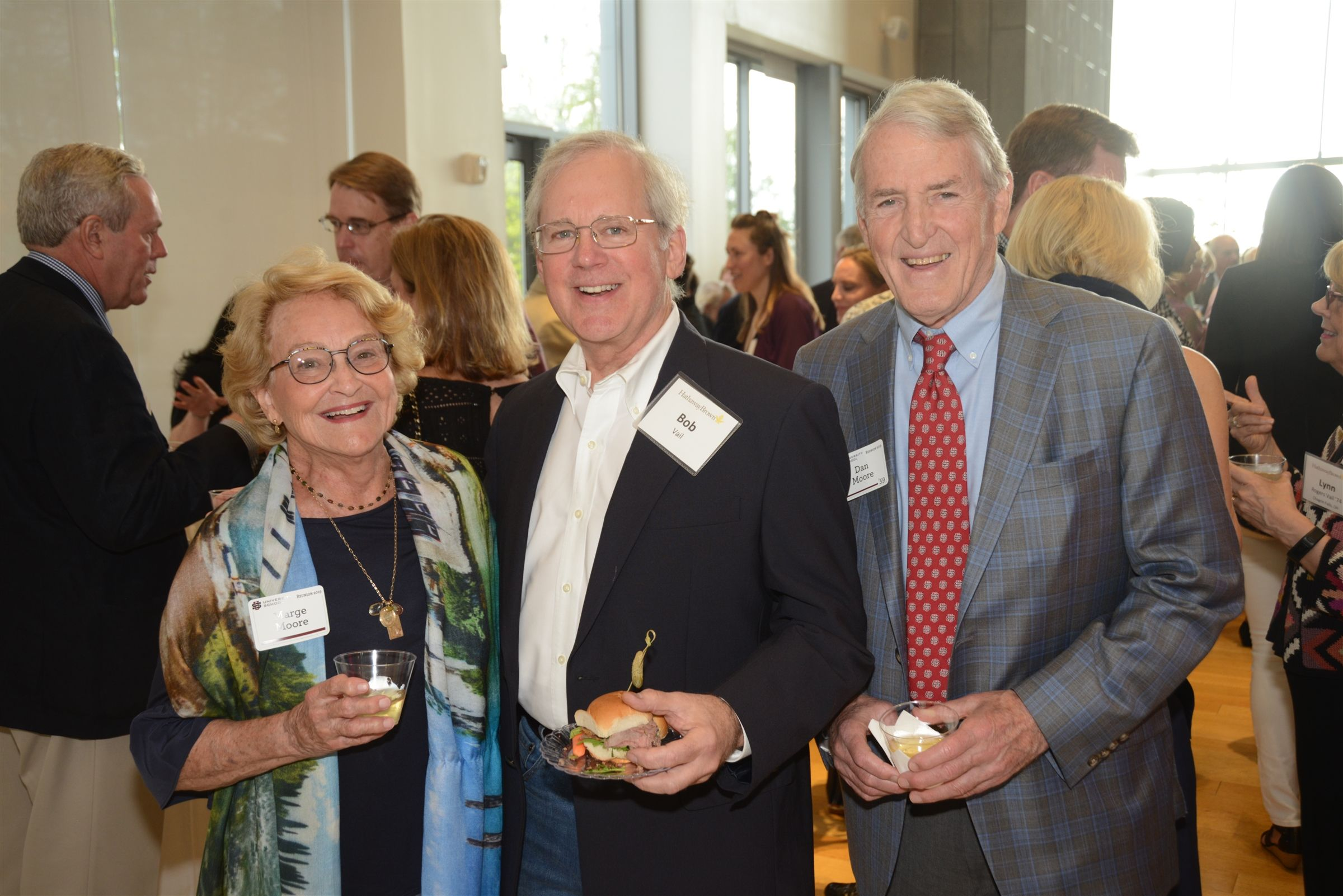 Former US faculty member Marge Moore, Bob Vail, and Life Trustee Dan Moore '59 enjoy the night at the Four School Reception.