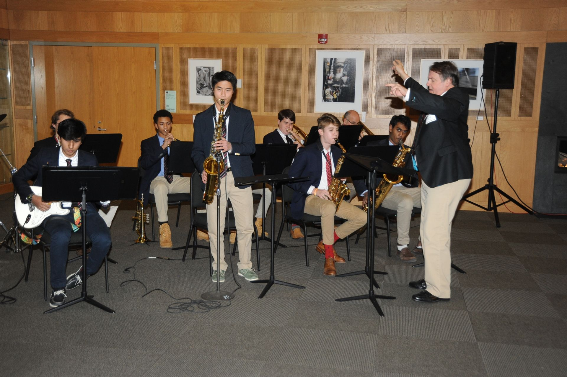 David Kay directs the Jazz Ensemble with Ben Chao '19 playing a solo on his saxophone.