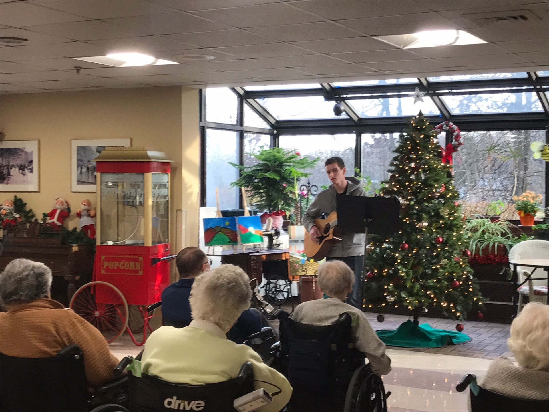 A program initiated by Coleman Walsh '18, Belmont Hill School musicians perform for senior citizens at MeadowGreen.