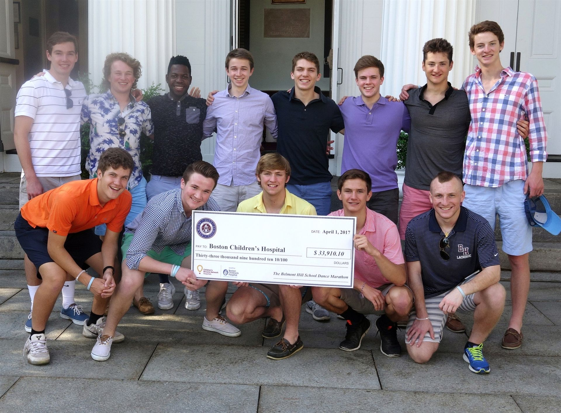After a successful Dance Marathon, Belmont Hill students presented Children's Hospital with a check for $33,910.