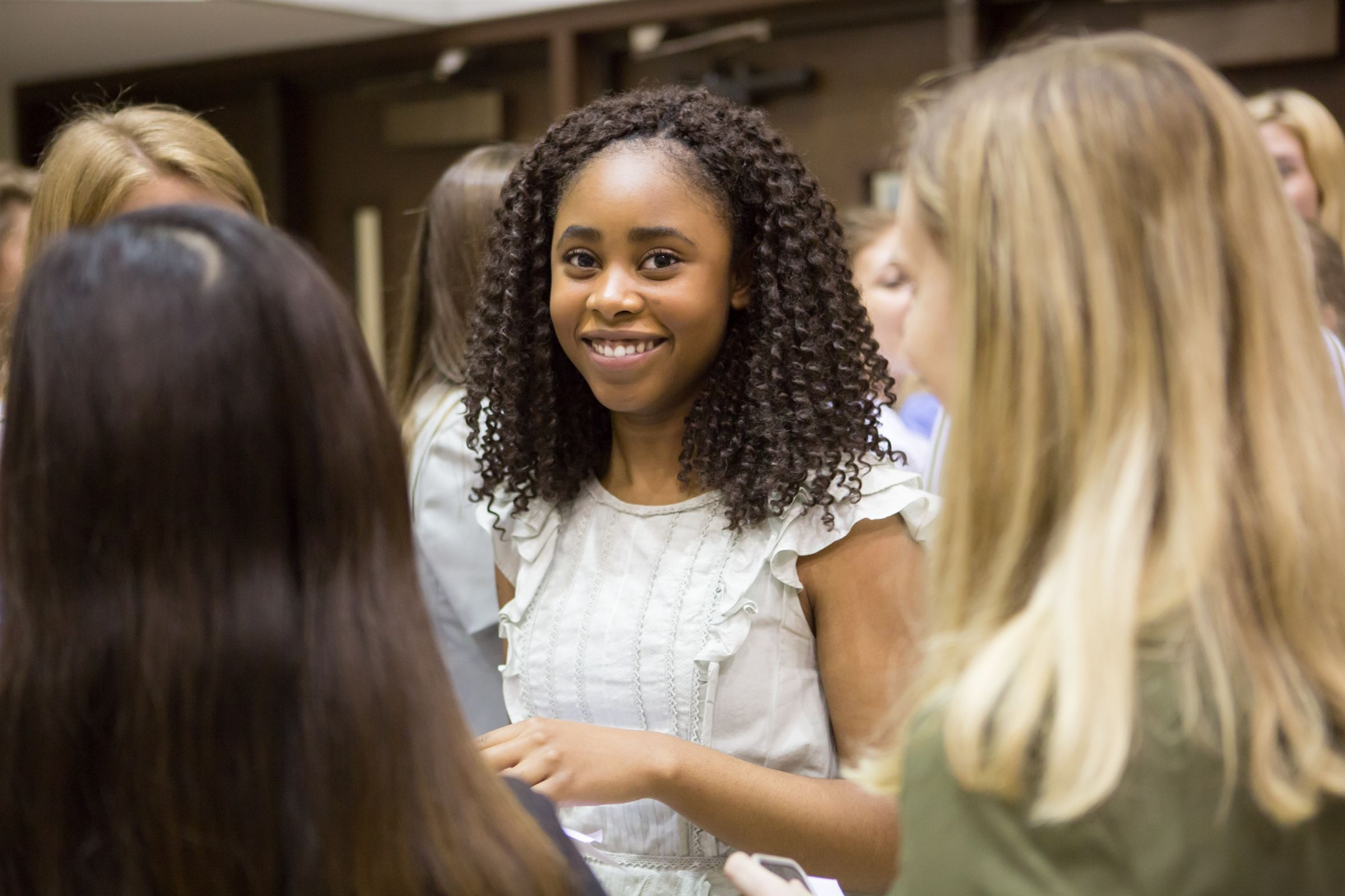 High school girl in a leadership position at Second Baptist School standing out in the crowd