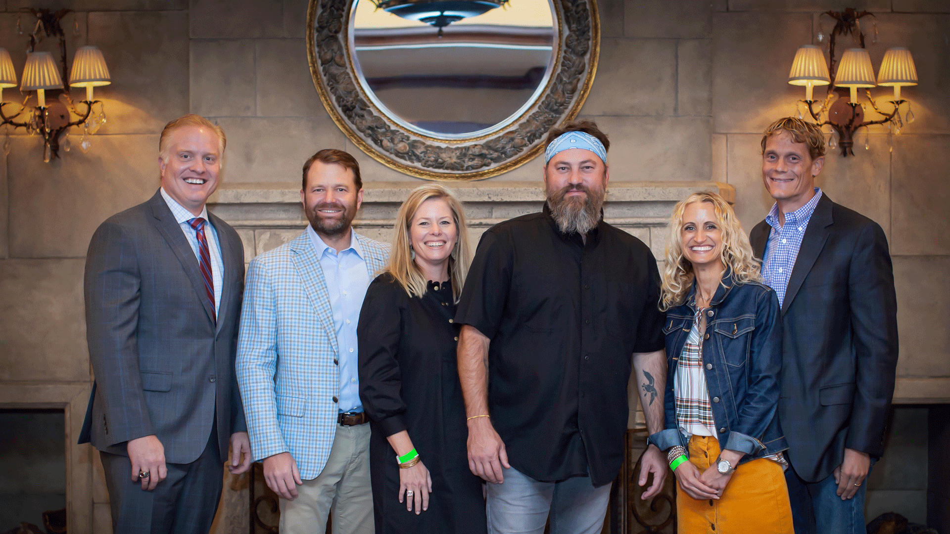 Head of School Dr. Don Davis poses with Distinguished Speaker Chairs and Willie Robertson