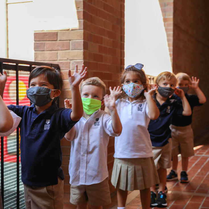 Lower School students walking to class with masks