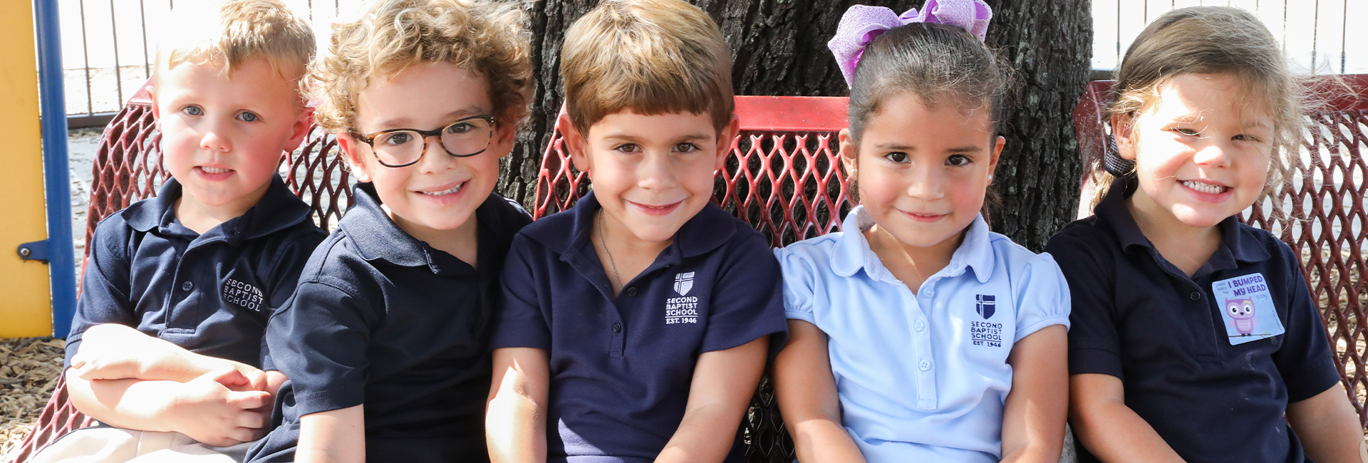 Boys and girls in the lower school at Second Baptist School gathered together on the playground