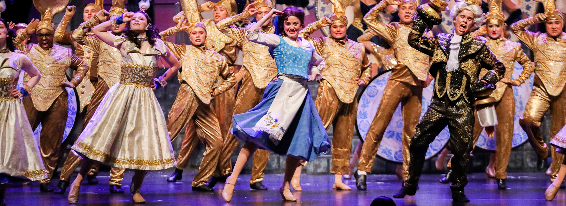 The cast performing a number from the Beauty and the Beast production