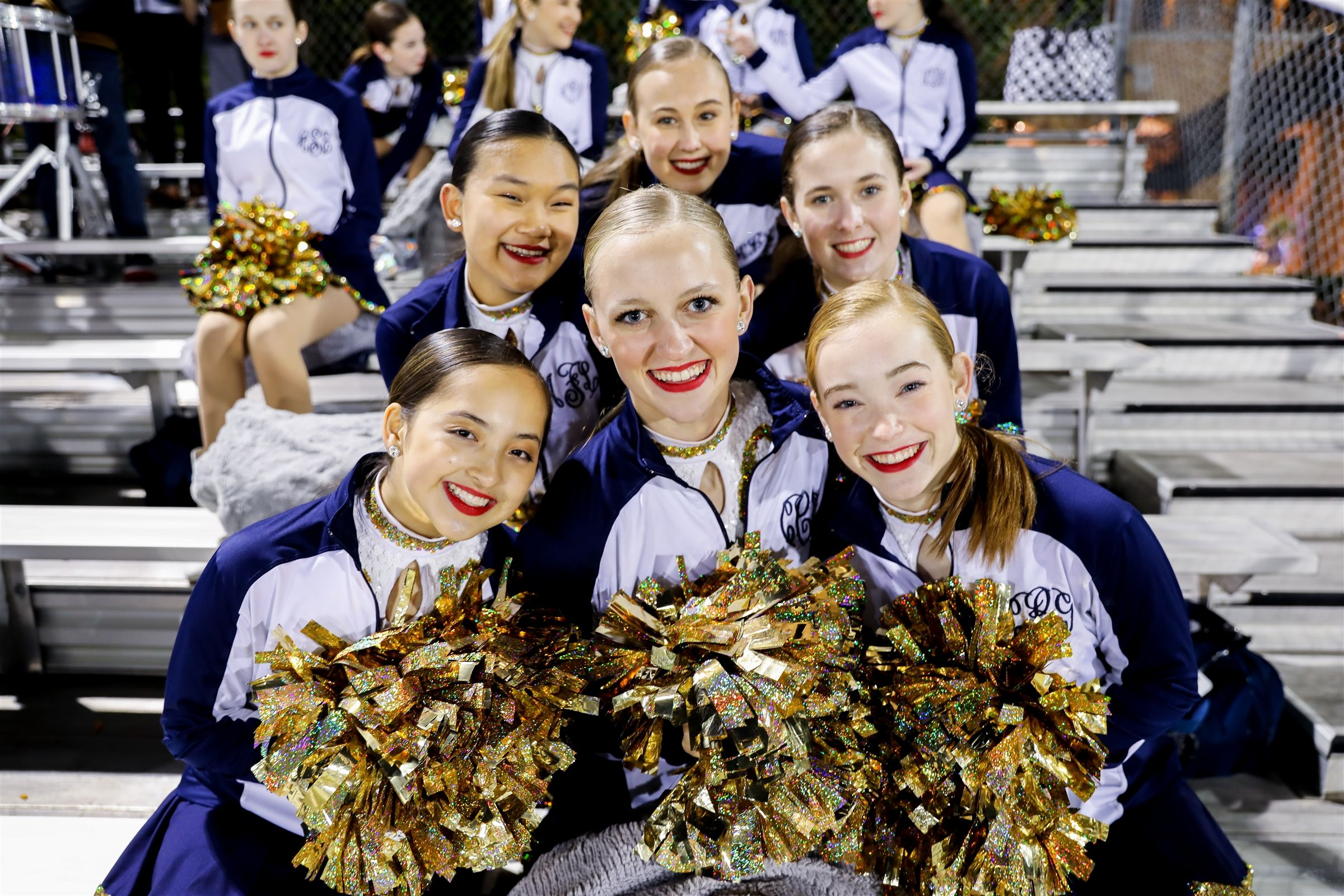 High school dance team members gathering in the stands for a home football game at Second Baptist School