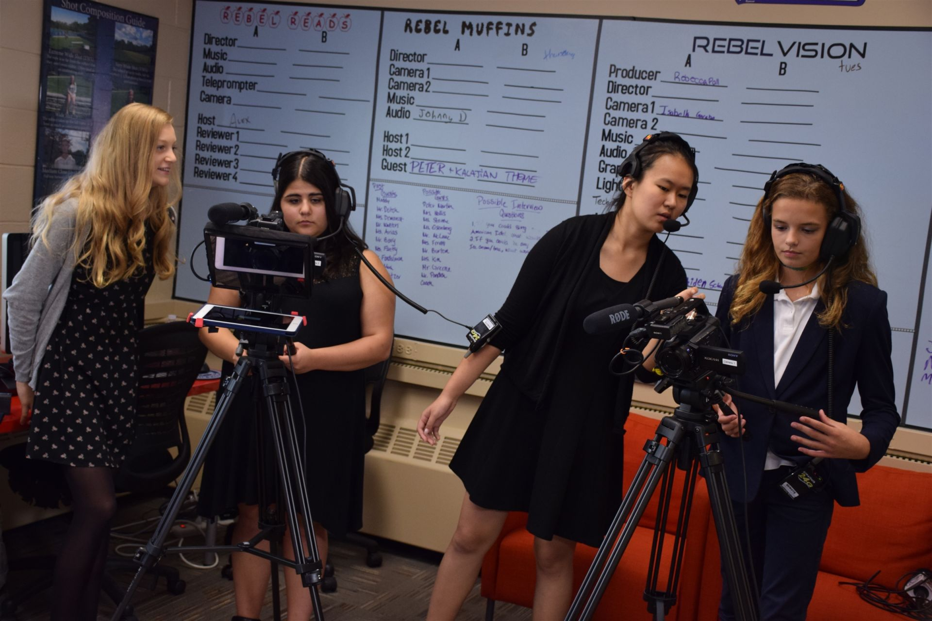 Upper and Middle School students work together in the RebelVision Studio, a fully equipped television production studio.
