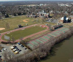 View of tennis courts, track and football field.