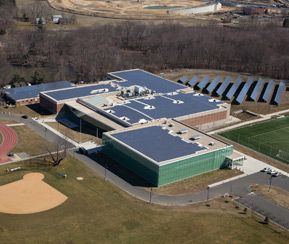 The recently-renovated Ian H. Graham '50 Athletic Center includes solar panels on the roof and behind the facility.