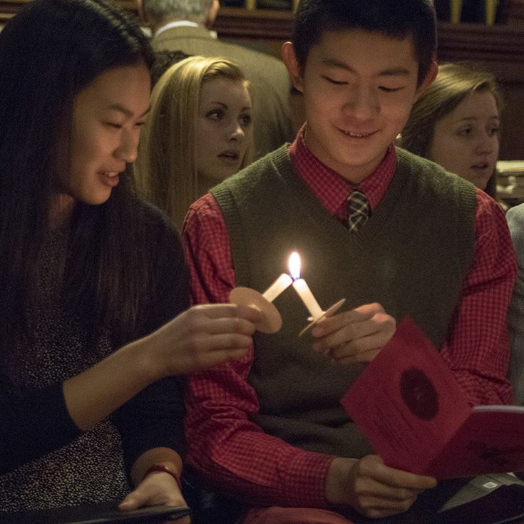 Lighting Candles in the Chapel of the Holy Cross